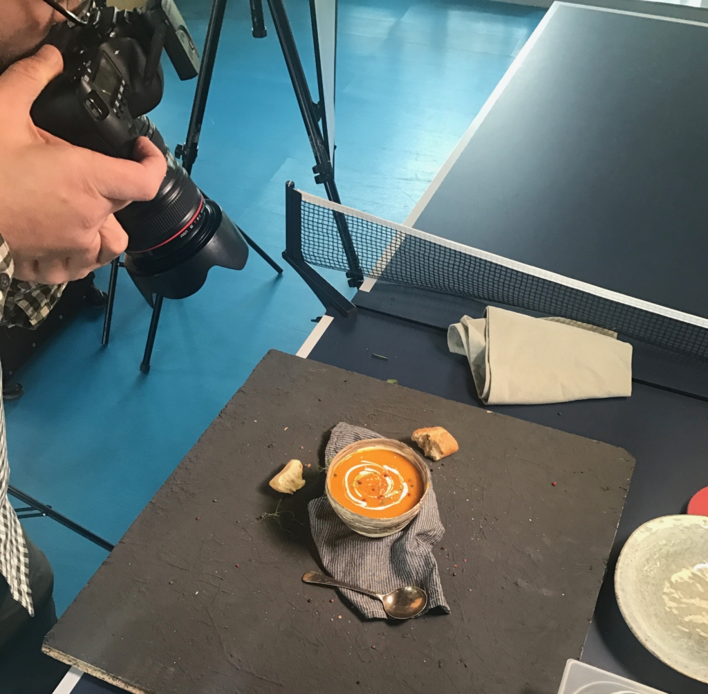 Taking a photograph of our butternut squash soup...on a table tennis table!