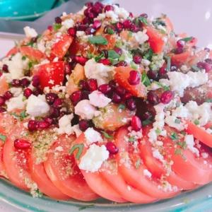 Tomato, feta and pomegranate salad relating to the recipe in text