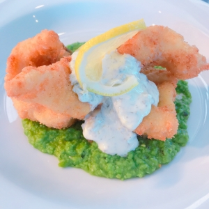 Plaice on top of a bed of minted peas