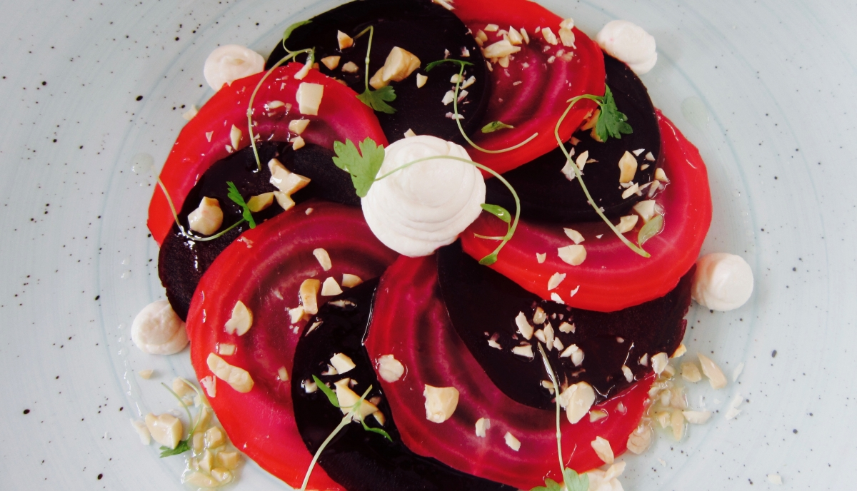 Picture of beetroot salad with toast cheese and hazelnuts.
