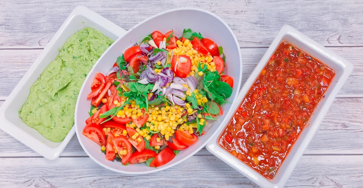 picture of avocado sauce, large salad and salsa