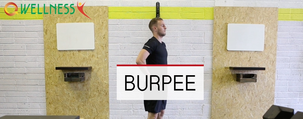 Person standing waiting to do a burpee, with a sign saying burpee