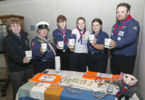 sea scout group holding compostable cups