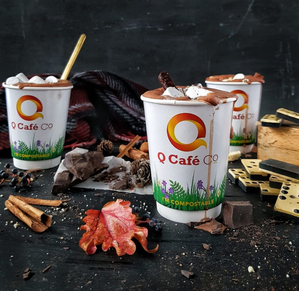 q cafe compostable cups containing hot chocolate
