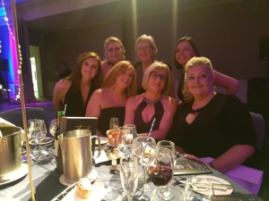 The Q Cafe Company ladies joining Breda at the table post award win.
