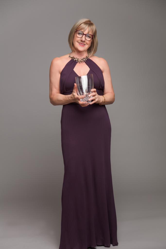 Breda Quigley with award